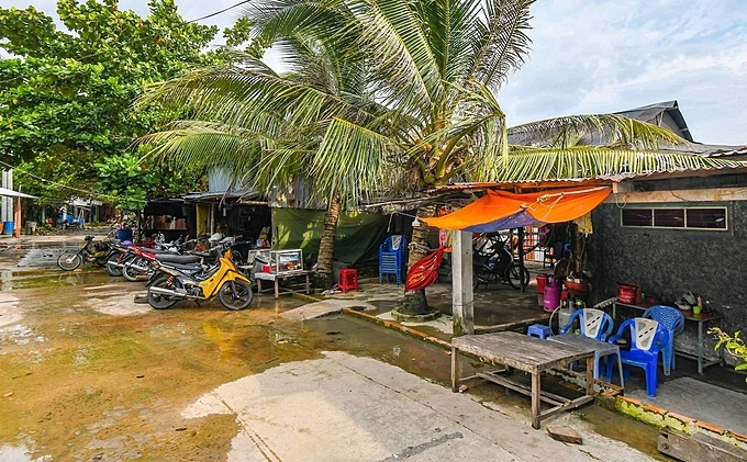 Some local shops where locals sell refreshment. There is a concrete road stretching around the Hon Tre island. It takes two hours to finish the round on foot.