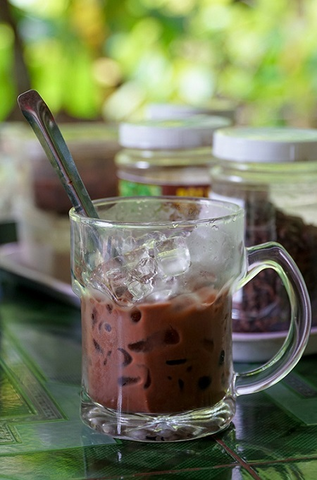 Cocoa powder mixed with boiling water and a dash of sugar or condensed milk turns into a delicious drink. Ice cubes are recommended if it is a hot day.