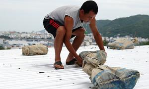 Vietnam closes airports, bans sailing as storm Matmo near