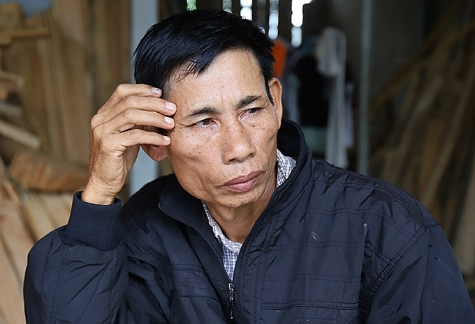 Nguyen Dinh Gia with a sorrowful face sits at a corner of his house in Can Loc District, Ha Tinh Province after British police announced that his son was one of the 39 dead vicitms in last months tragedy. Photo by VnExpress/Duc Hung.