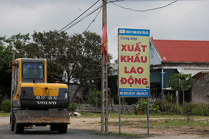An advertising billboard for a labor export company in Ha Tinh Province, October 28, 2019. Photo by Reuters/Kham.