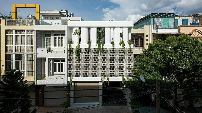 Designed by Khuon Studio, House for a Daughter in HCMC contains 2 zones, one for a family who usually visits the house and another for their daughter.