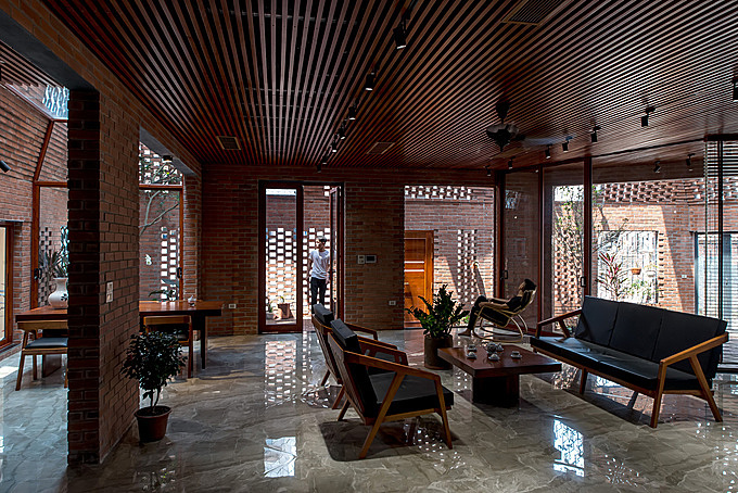 The brick walls connect the interior space with the nature. They can be a filter to keep bright sunshine, dust and noise out of the main living spaces. Photo by Archdaily/Nguyen Tien Thanh.