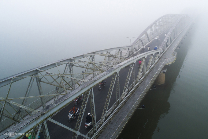 Truong Tien Bridge crossing over the Perfume River is smothered in fog.