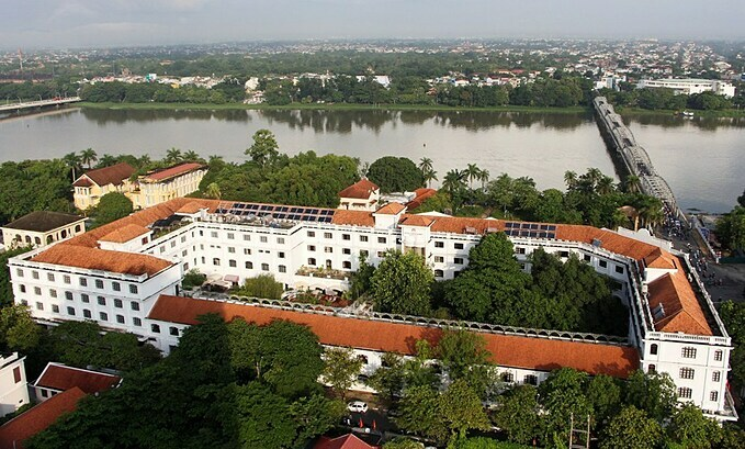 Saigon - Morin Hue was built in 1901 during the French colonial time, Densen greeen trees have become a highlight for the hotel overlooking the Perfume River.