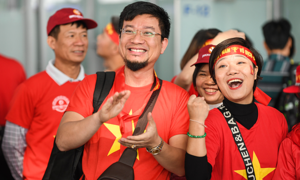 Vietnam airports awash in red as football fans head for the Philippines