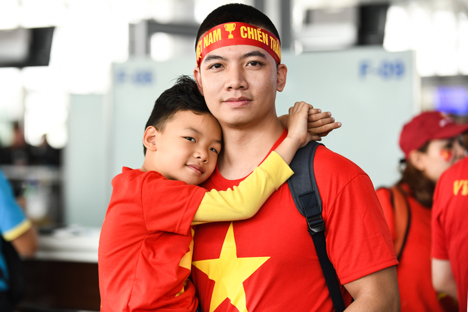 Nguyen Viet Hung, 5 (L) and his uncle Bui Tien Dat are among the ones flying to the Philippines to cheer for the national team. They are accompanied by Hungs mother, Bui Thu Hien.We couldnt do anything yesterday as we were too excited to go [to the Philippines], said Hien.