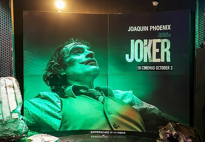 A standee of Joker movie at a cinema. Photo Shuttlestock/chingyunsong.