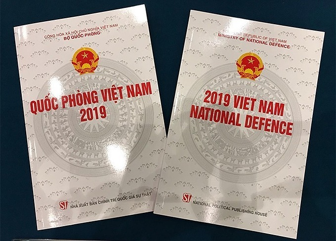 The Vietnamese and English versions of the 2019 White Paper on Vietnams National Defense. Photo by VnExpress/Gia Chinh