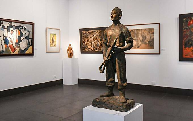 The sculpture of a soldier by artist Nguyen Thi Kim is an amalgam of oil paint, lacquer, silk, wood, and soil.