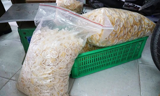 A police photo shows fake condoms to be packaged as popular brands at a facility in Ho Chi Minh City.