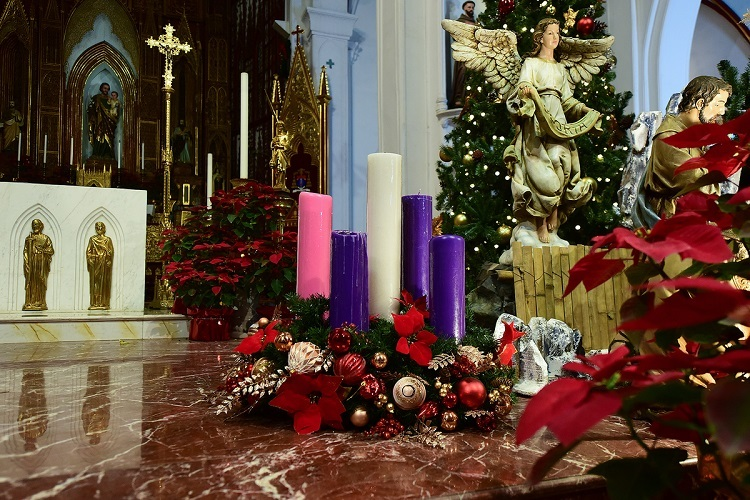 Five large Advent candles stand next to the nativity scene. Each of the four shorter candles represents a Sunday that precedes Christmas whilst the tallest candle in the middle is lit on Christmas Day to celebrate Jesus's birth*.