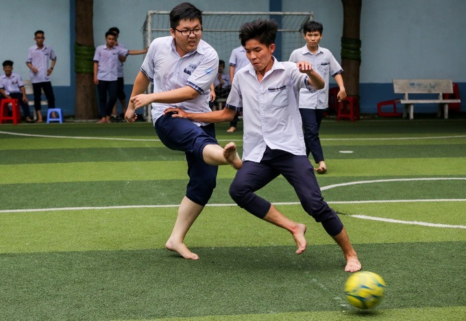 High school boys play football at a school in Ho Chi Minh City. Photo by VnExpress/Quynh Tran.