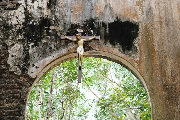 The old cross depicting the death of Jesus is still polished and cleaned regularly. Though a new churchserves local believers, many Jrai, a big minority community across Gia Lai, still attend the old church every day, carrying with them flowers and prayers.