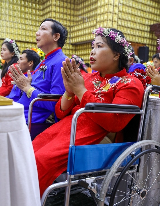 We grew up on wheelchairs, working as garment workers for a living. Born in poverty, weve been with each other for nearly 15 years, but never dared to have a wedding like others. But today, it has come true, said Mai Thi Tuoi, 35 (R).