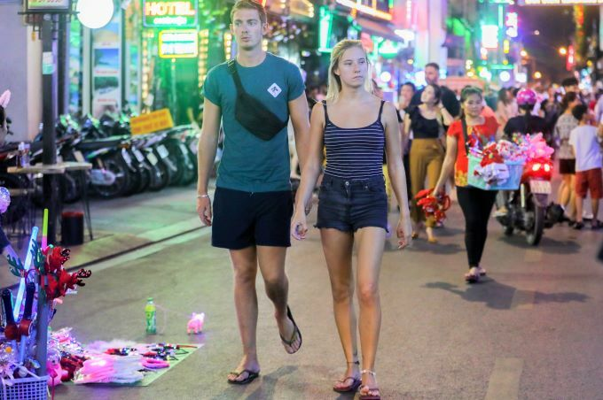 Foreign tourists walk on Bui Vien pedestrian street in downtown HCMC. Photo by VnExpress/Quynh Tran.