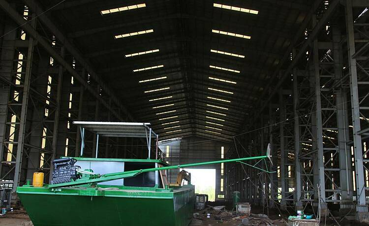 With the factory's operating license nullified due to contract breach, before a new investor is found, the main building has been used by locals to fix their private boats.