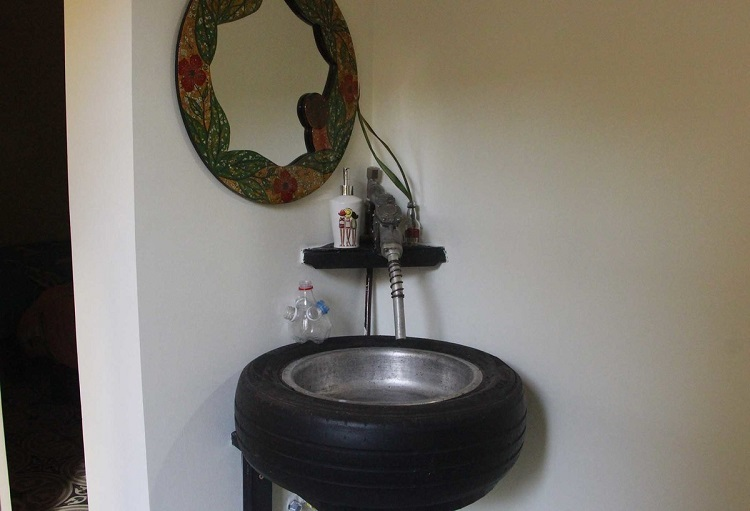 This wash basin is made of a rubber tyre and aluminum brass, while the fuel pump nozzle serves as faucet.
