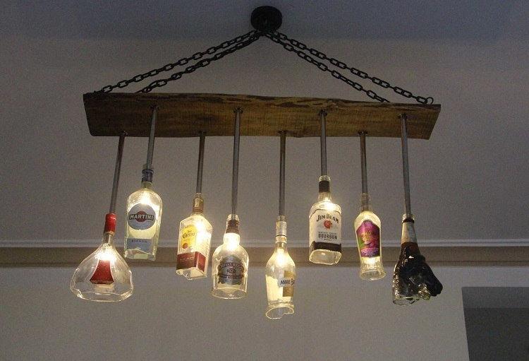 Emptied glass bottles combined to make a new chandelier.