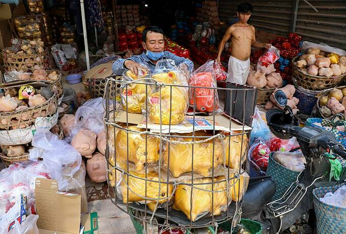 Merchant Doan Van Het loads his bike with statues to sell in Ho Chi Minh City.  According to the owners, domestic demands for these kinds of products come from the southern and central provinces, while some are exported to Laos and Cambodia.