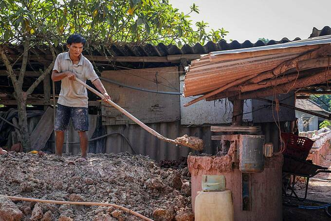 Tran Van Manh, 50 a worker at Hops factory shovels clay into a mixer. Clay, water, and glue are put together and mixed. The clay is bought in Ben Cat district in Binh Duong. It has a strong and smooth texture, very suitable for pottery making.  Every day, I have to mix more than a ton of clay. Often newcomers do this job, said Manh, who has been in the pottery making for two years.