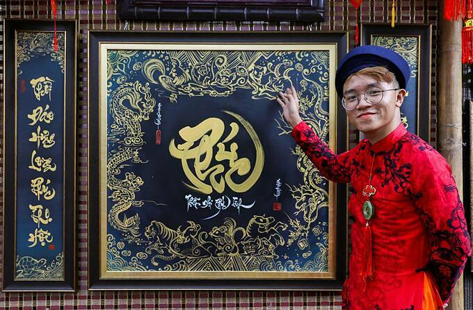 Xuan Thanh, 20 has seven years of giving the words in Saigon.  This is the one I like most which has 12 Chinese zodiacs, circling the word 'bliss' which is what lots of people usually expect when a new year nears. A customer asked to buy this work for VND10 million, Thanh said.