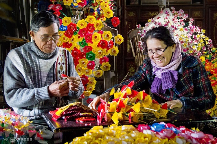 Thanh Tien Village is situated in Phu Mau Commune,  Phu Vang District, about 7 kilometers from downtown Hue, Vietnams former imperial capital.Locals make two types of paper flowers - multicolored varieties of various floral species and  lotus flowers. Both are used for worship and as home decorations, apart from being sold as souvenirs to visitors.
