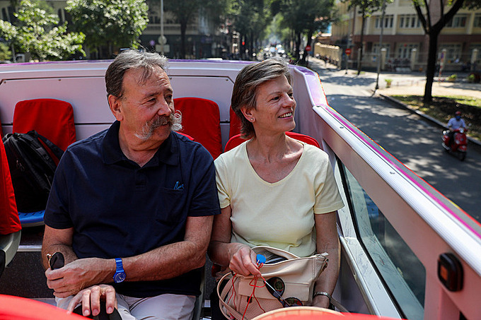 Robi and his wife from Sweden are among the passengers of Saigon's double-decker bus service which Robi said he's quite pleased with.  Sightseeing on a bus allows him to visit many places and save time and energy on the fly. Foreign visitors can listen to an automatic interpreting audio voice at each attraction, Robi added.