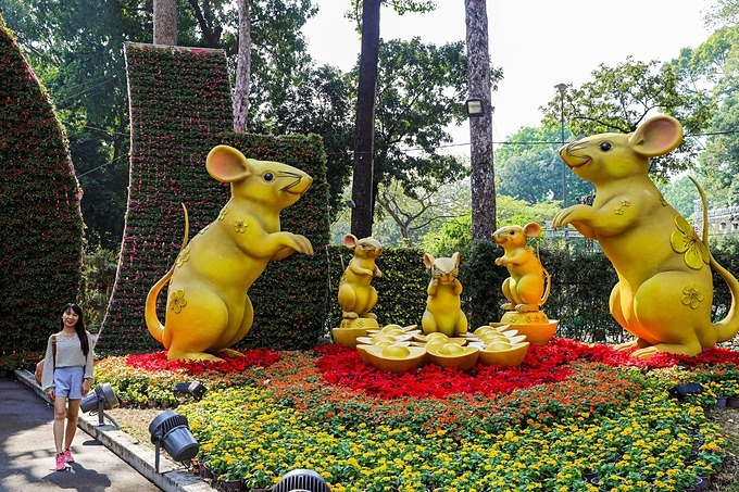 Right at the entrance of the festival on Truong Dinh Street is a family of golden rats with the three-meter-tall parent rats and three little mice standing ready to welcome visitors. For many years now, the Tao Dan spring flower festival is one of the most expected festivals during Tet, the countrys biggest and most important festival, in HCMC. The Year of the Rat will peak this Saturday.