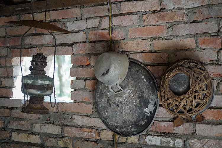 Modest kitchenware was also placed in the house.