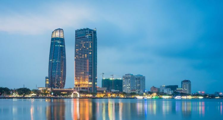 Buildings seen by the Han River in Da Nang City, one of the most popular tourist destinations in Vietnam. Photo by Shutterstock/Vietnam Stock Images.