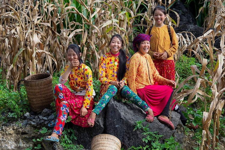 Girls pose in the colorful traditional clothes of the Hmong, one of the largest ethnic groups in Vietnam, in the mountains of northern Ha Giang Province. Photo by Nguyen Son Tung.