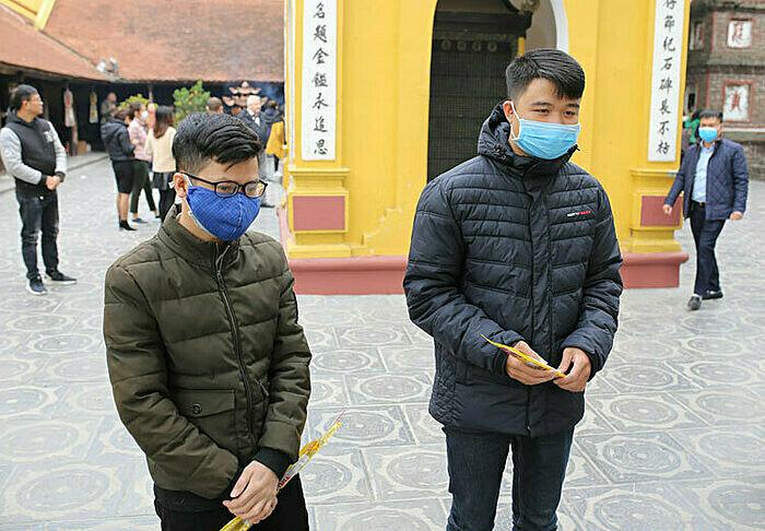 Son and Ha wear masks while visiting Tran Quoc Pagoda. Photo by VnExpress/Tat Dinh.