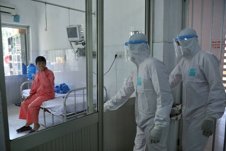 Doctors of Saigons Cho Ray Hospital monitor the health of Chinese nationals Li Ding, 66 and his son Li Zichao (pictured), 28, February 3, 2020. They are the first two confirmed cases of nCoV infection in Vietnam on January 22. They are both being quarantined.
