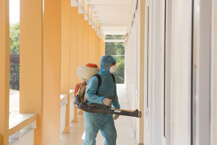 A soldier disinfects a military office in Thua Thien-Hue Province, central Vietnam, to serve as isolation area for Vietnamese citizens to be coming back from China, February 5, 2020. Photo by VnExpress/Vo Thanh.