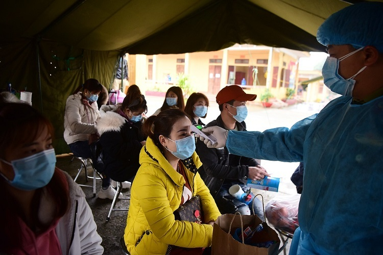 All the quarantined have their body temperatures checked. They also have to provide info on their work location in China and their residence in Vietnam.