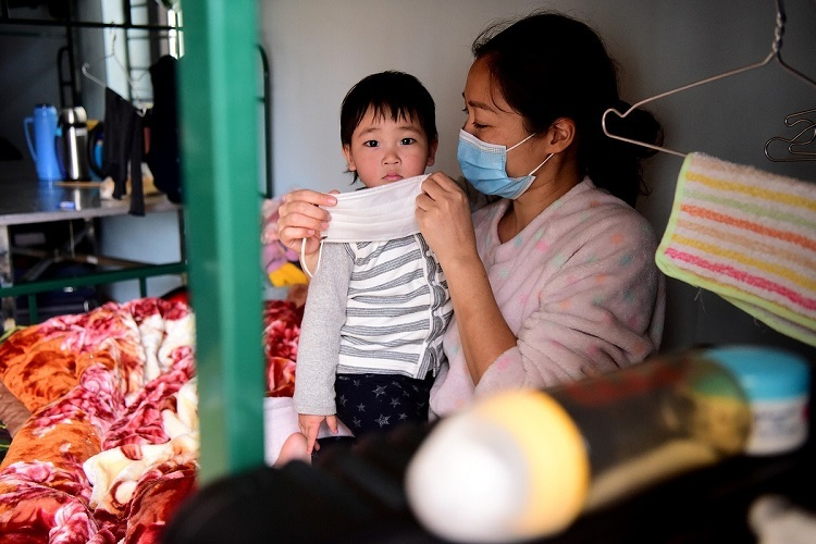 Tam and her 2-year-old daughter visited a relative in Chinas Nanning City and returned to Vietnam on February 3. She knew she would be quarantined when she returned.Its fine here, I get to be in the same room with other mothers... The children get 3 extra porridge meals [per day], she said.