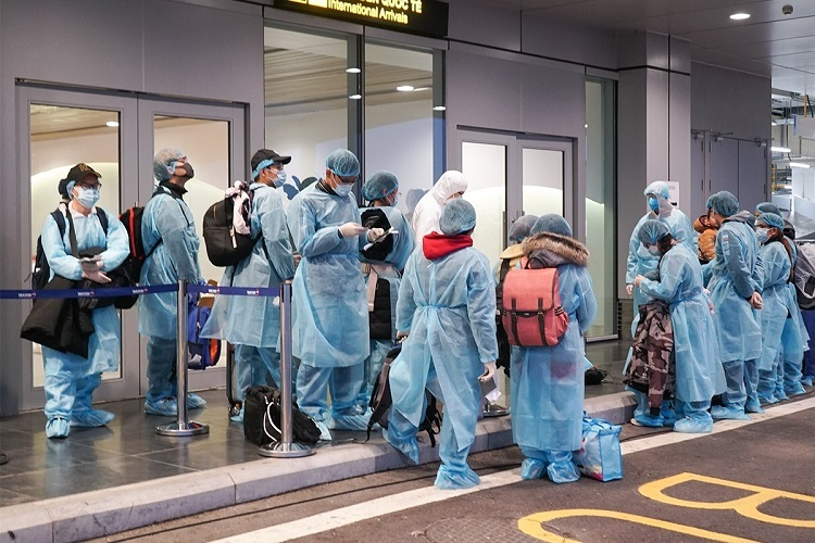 Passengers undergo check-in procedures in protective suit.As of Tuesday, Vietnam has confirmed 15 cases of nCoV infection. The latest being a 3-month-old girl in Vinh Phuc Province, a grandchild of one of the previously infected patients.