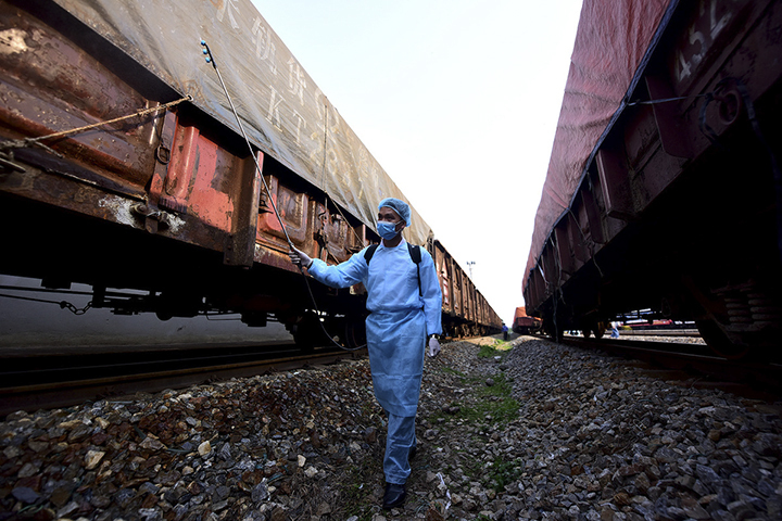 Once a train arrives, medical personnel come to spray disinfectants all over it.