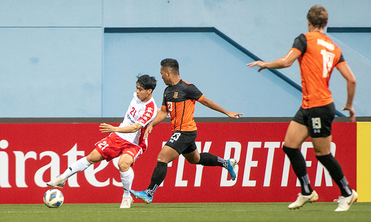 Nguyen Cong Phuong (in white) tries to dribble past a defender. Photo courtesy of Asian Football Confederation.