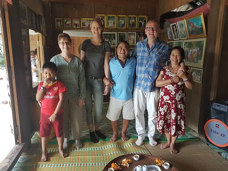 (From L) Karin Redlich, Lotta Redlich, Friedhelm Redlich posed with local Vietnamese they met in Hoi An during their trip in Vietnam in January, 2020. Photo courtesy of Friedhelm Redlich.
