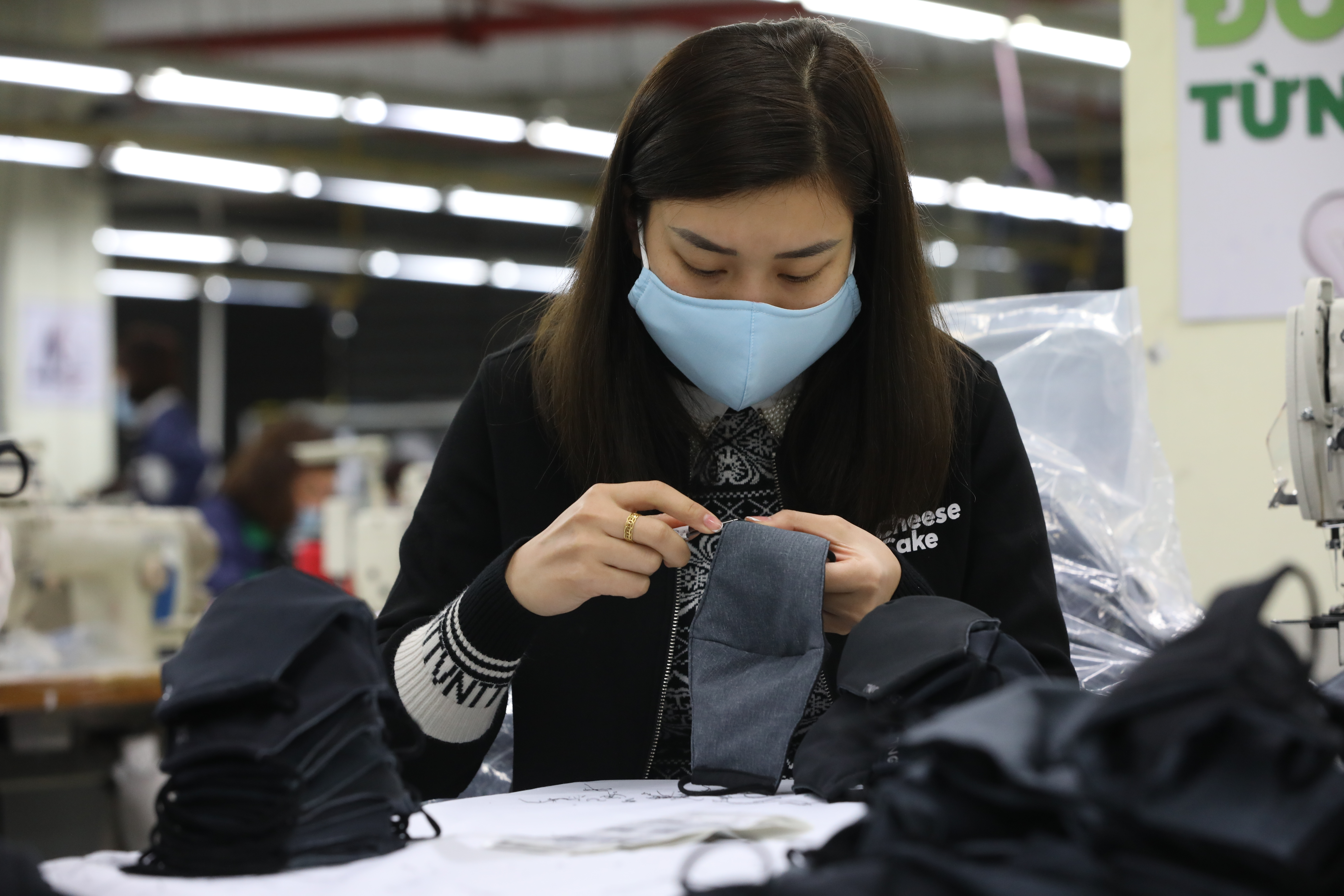 Textile factories shift production from clothes to masks