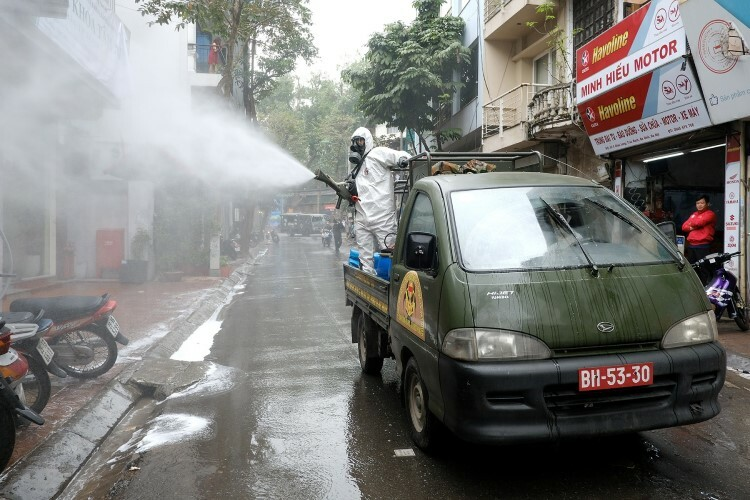 Chemicals are sparayed along the Chau Long Street, which connects with Truc Bach.