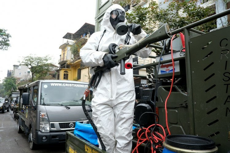 A soldier of the Chemical Division wears a protective suit and is equipped with a chemical gun.
