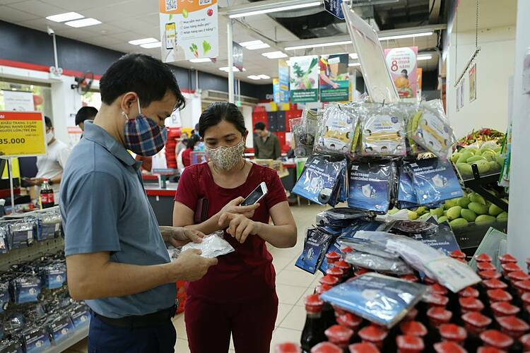 Face masks were sold in large quantities at Vinmart on Sunday.