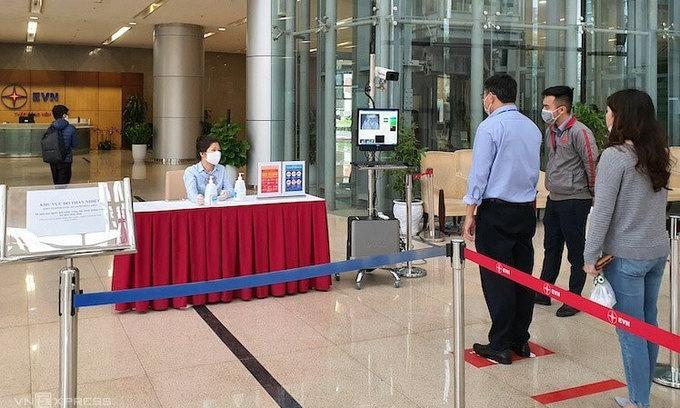 Businesses adopt remote working as new coronavirus clocks in