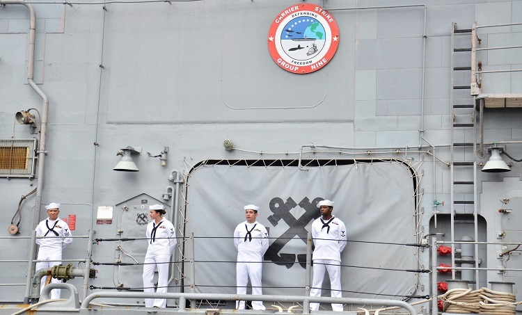 Crew members stand aboard the USSTheodore Roosevelt as it docks in Da Nang for a visit between March 5-9, 2020. Photo courtesy of the U.S. General Consulate in HCMC.