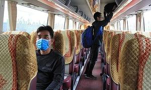 Hanoi bus companies cut trips as coronavirus bites