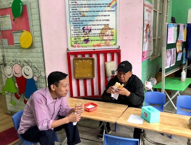Two men have breakfast at Hugo Kids Kindergarten in Hanoi which is turned into an eatery amid the coronavirus epidemic. Photo courtesy of Hugo Kids.