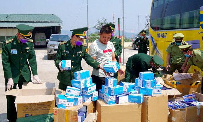 Man caught taking 30,000 face masks to Laos